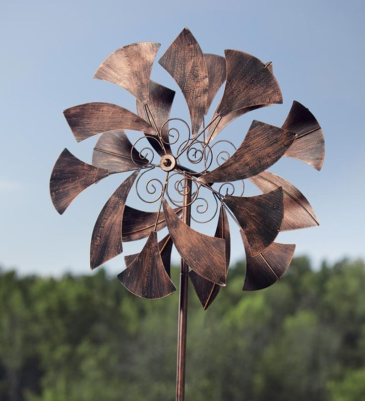 "Metal Sail Wind Spinner --    • Mesmerizing kinetic art • sail-shaped accents catch the wind • Two wheels of sails spin in opposite direction  • Beautiful in any setting and delightful in any season  --  24"" dia. x 75""H  --  $90"