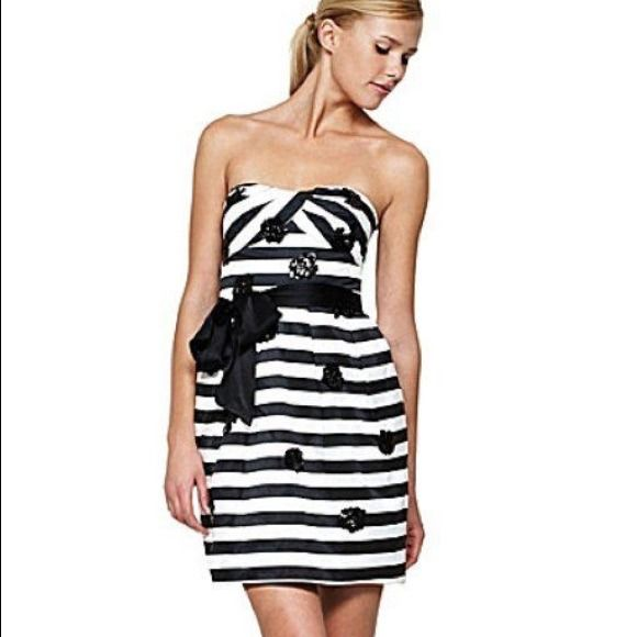 BCBGMAXAZRIA  holiday cocktail strapless dress BCBGMAXAZRIA black and white striped strapless dress with sequence. Tulip shaped skirt with pockets. Boned bodice, detachable straps. Fully lined. Cotton/ polyester. New with tags. Best offer. BCBGMaxAzria Dresses Strapless