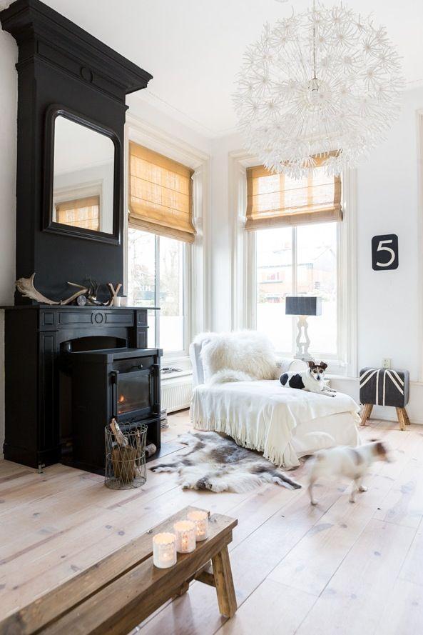 .Black chimney in a white room