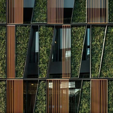 beautiful facade with living walls, wood, metal and glass | Vertical Living Gallery in Bangkok Thailand |Architects: Sansiri PCL | Landscape Architect: Shma Company Limited | (Photo: Wison Tungthunya)