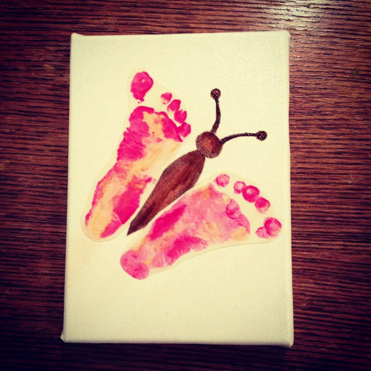 Baby butterfly footprints.  Press feet on paint covered newspaper. Then press feet on white paper. Cut the feet out and glue them to a canvas that you can paint on then Modge Podge over top of the whole thing.