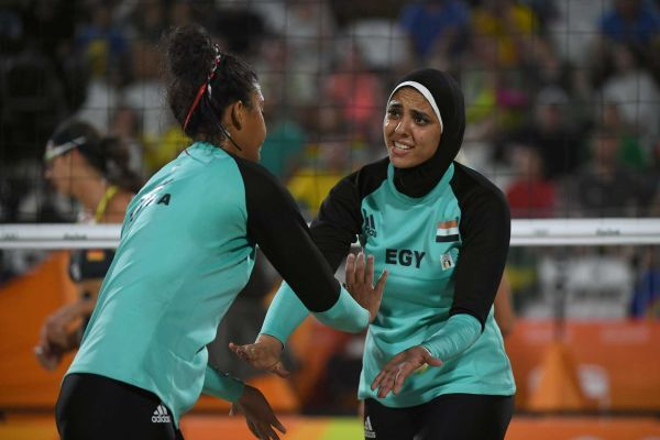 Egypt's Nada Meawad (L) and Egypt's Doaa Elghobashy react during the women's beach volleyball qualifying match between Germany and Egypt at the Beach Volley Arena in Rio de Janeiro on August 7, 2016, for the Rio 2016 Olympic Games.