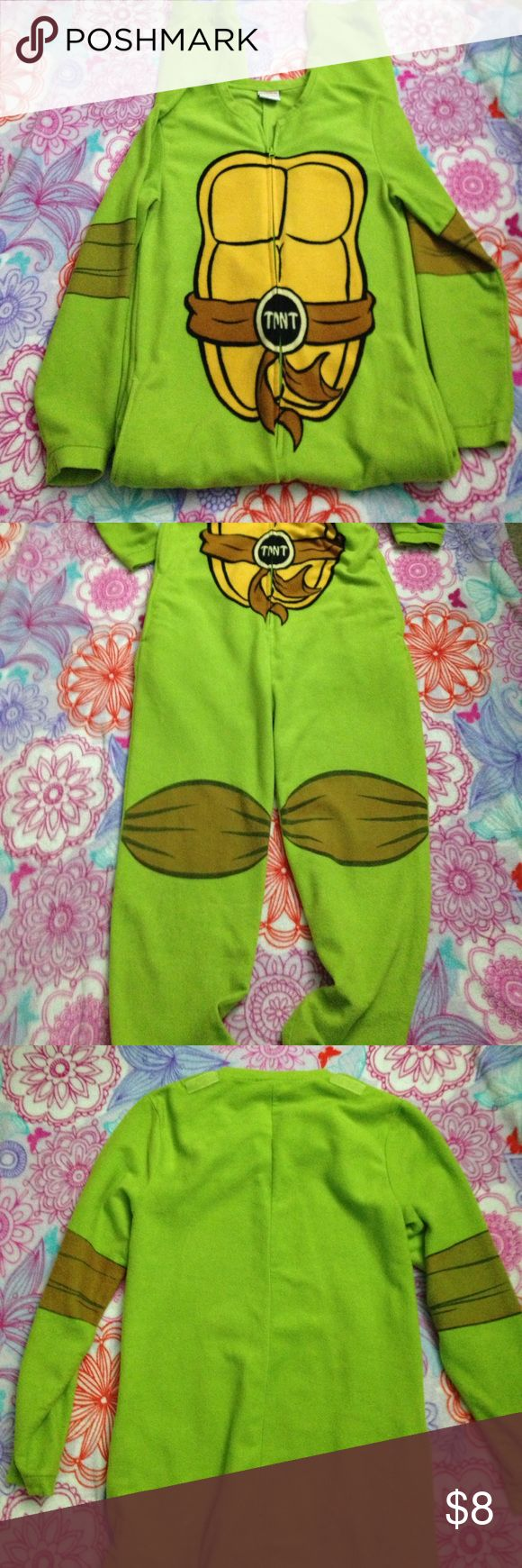 Teenage Mutant Ninja Turtles Onesie 1 Ninja turtle onesie. Zips up the front. There is velcro on the back at the shoulder but I don't have the cape that attaches. The graphic on the knees and elbows is faded. The center graphic is perfect. Would be great for Halloween. Other
