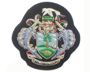 Seychelles Customs Cap Badge.  http://www.handembroidery.com/