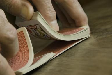 Senior man shuffling cards - Anne Rippy/Photographer's Choice/Getty Images
