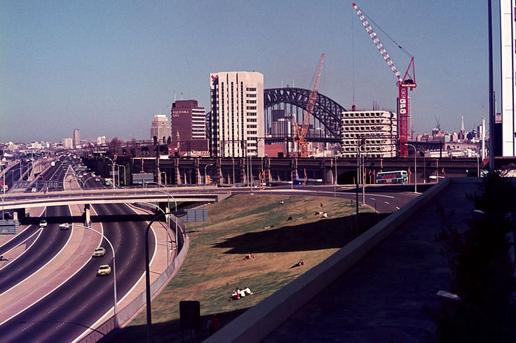 North Sydney skyline at its infant stage 1972 Note: the people having their lunch on the grass facing a hwy!