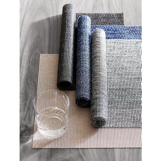 Shop net placemats.   Indoor/outdoor waterproof mats never fade.  Close weave adds texture on a tonal background.  Gives an instant contemporary edge to your table.
