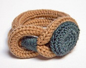 Spool knitted bracelet with crochet button