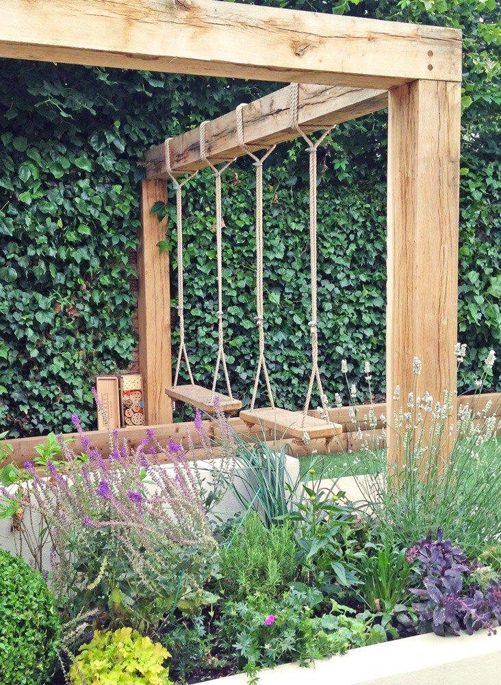 We designed this Swing Garden to be functional and low maintenance with a playful focus. Features include swings, pergola and outdoor kitchen.