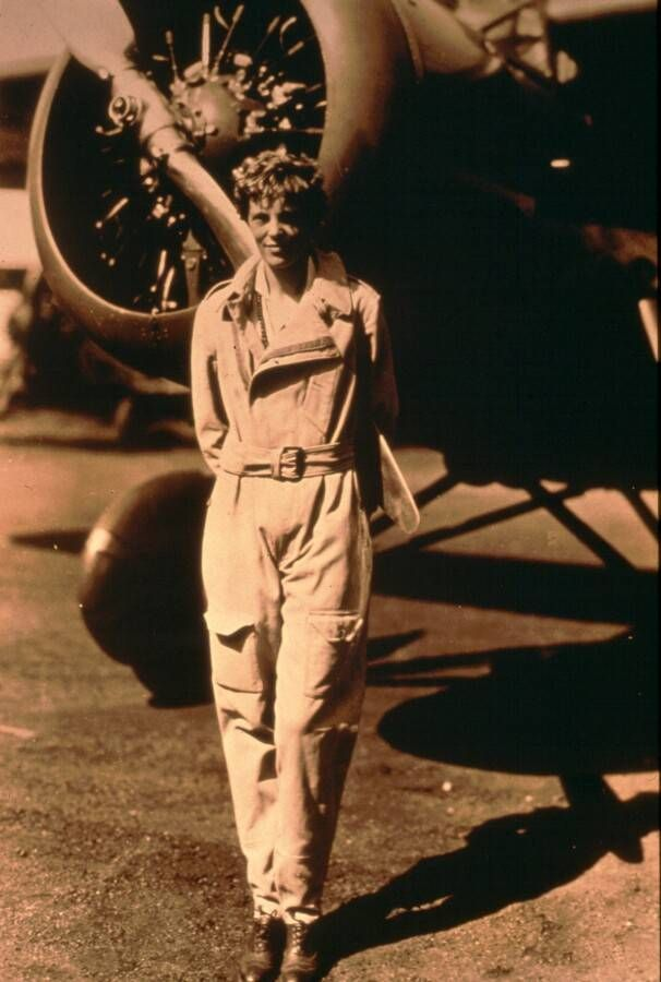 Amelia Earhart Standing in Front of Plane - Undated