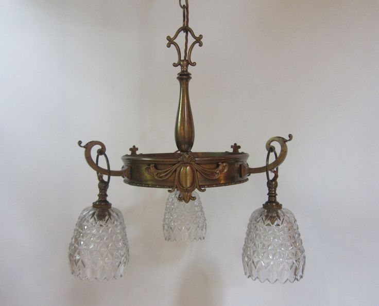 English three arm ceiling light in the original patinated brass finish complemented by period cut glass shades. www.antiquelightingcompany.com