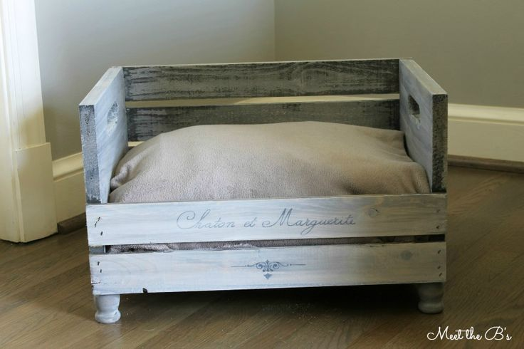 "The Great Crate Challenge- DIY Pet Bed: So let's get started, shall we? Here's how I made it...  Supplies: Wooden crate from Michaels Four wooden candle holders or small furniture legs Wood glue Wood stain (I used Minwax in ""classic grey"") Paint (I used Americana Decor's Chalky Finish) Permanent marker"