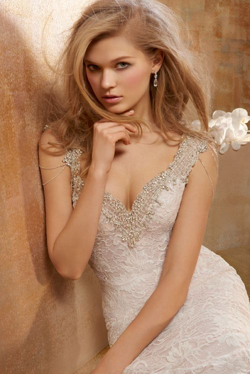 Beautiful Allure Slip into this lace sheath for a delicate striking bridal look
