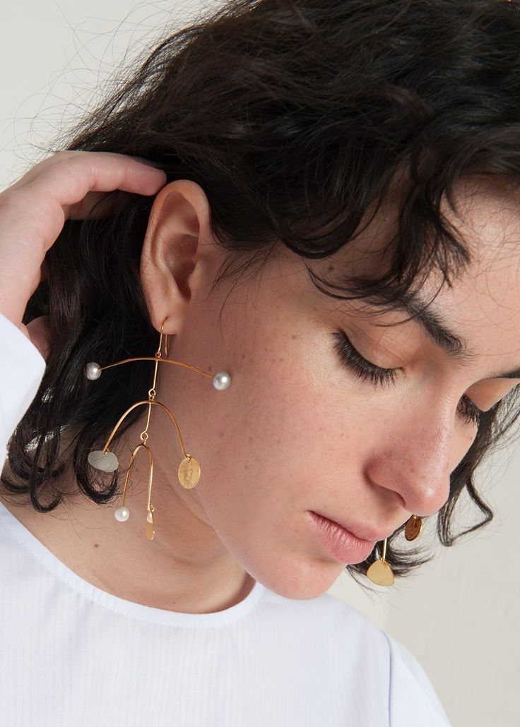 "#newarrivals #jewelry #beccajewellery #peggy9 #peterjensen #mobile #earrings #brass #goldplated #vermeil #accessories #thefrankieshop #frankiegirl #frankienyc Mobile Style Drop Earrings w/ Gold Shapes, Mini Engraved Coins & Pearls Decorations. Fish Hook Fastening  22K Yellow Gold Plated Silver   3.25"" H x 3.25"" W - 6.6g per Earring  By Becca Jewellery For Peter Jensen. Handmade in the UK"