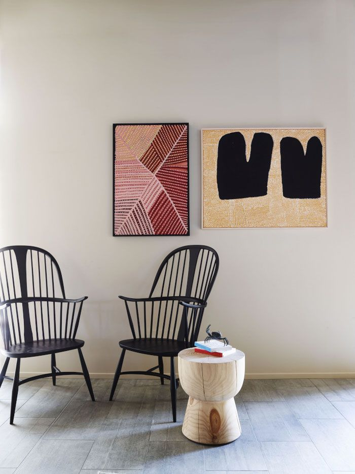 Here A Pair Of Updated Wingback Chairs Stand Against Collection Aboriginal Art Mixing American And Australian History