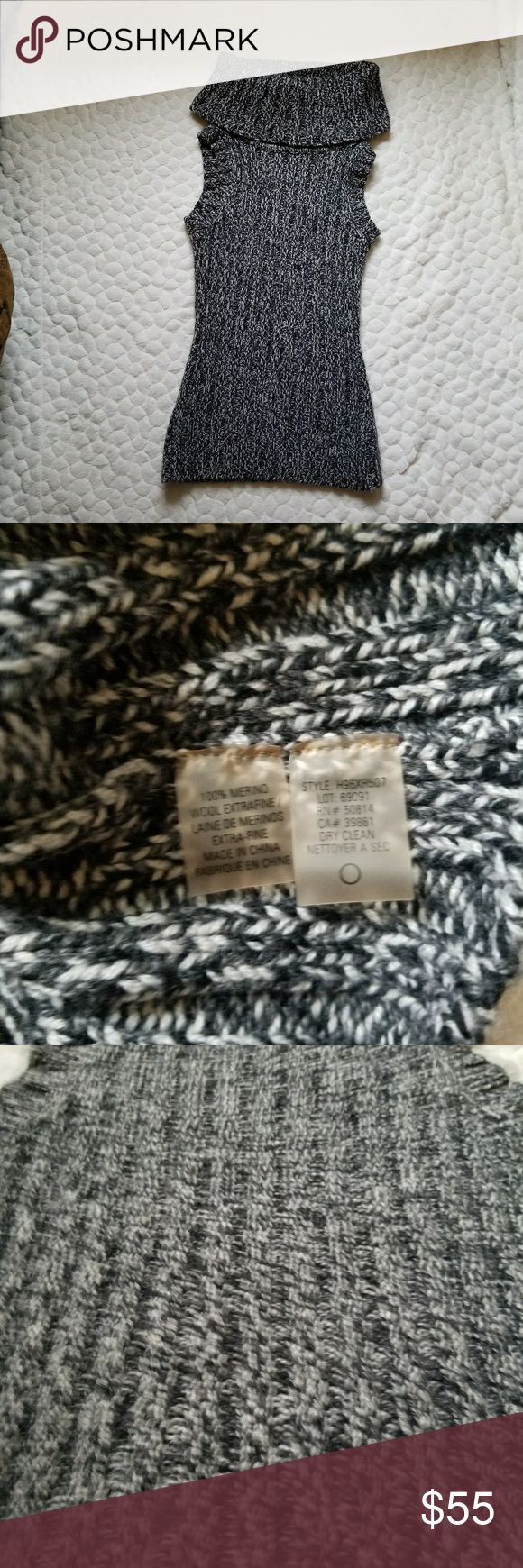 Signature Saks Fifth Avenue Merino Wool turtleneck ******Saks 5th Ave Merino wool sleeveless turtleneck. Size is small. Really thick and warm. Cure and classy fit. Black and white to create a grey look from a distance.****** Saks Fifth Avenue Sweaters Cowl & Turtlenecks