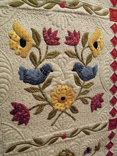 "close up,  ""Heartland"" by Sue Maitre, quilted by Linda Hrcka. Design by Pearl Pereira; photo by Quilt Inspiration"