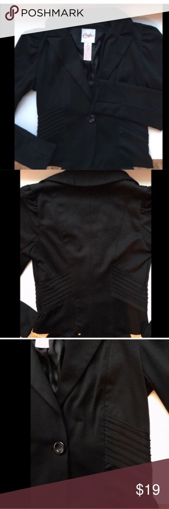Candies black button up jacket This classy black jacket will complete any outfit! Whether it goes over your favorite dress or worn with jeans and heals. It has only been worn a couple times and looks brand-new. Jacket has a collar and slightly puffed sleeves with one large button to close off the front. Material is 78% polyester, 17% rayon 5% spandex. Contrast 100% polyester lining. Candies Jackets & Coats Blazers