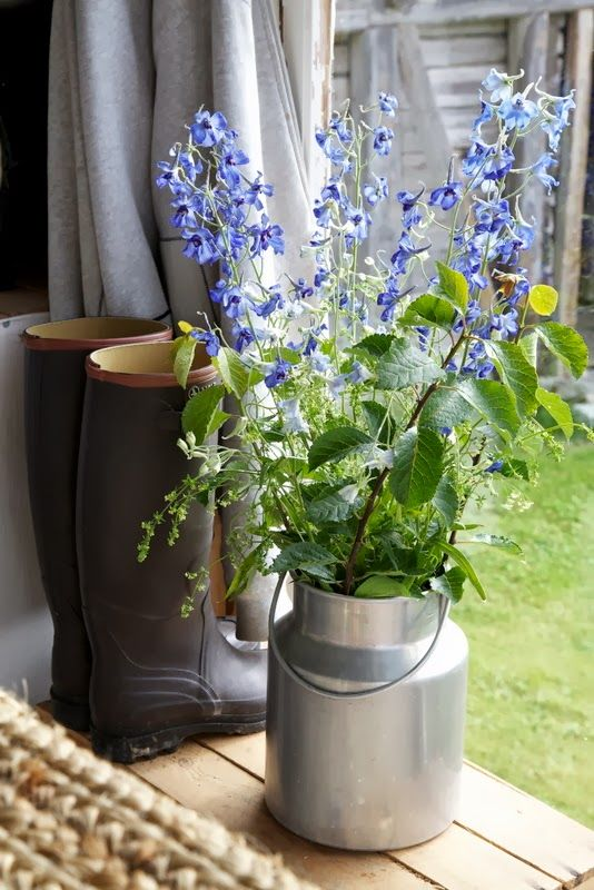 flowers in a small milk can