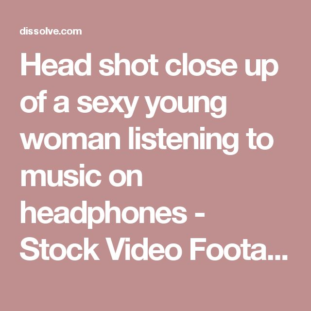 Head shot close up of a sexy young woman listening to music on headphones - Stock Video Footage - Dissolve