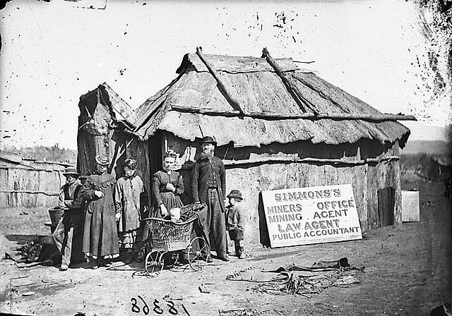 Simmons (miners office, mining agent, law agent and public accountant) and family outside his bark hut, Gulgong area, 1871-1875 / American & Australasian Photographic Company