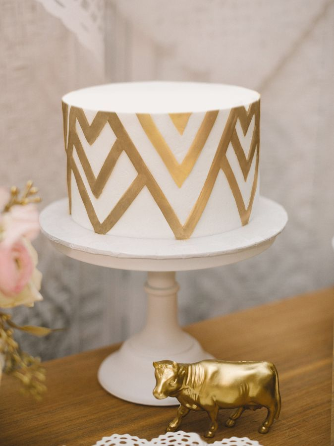 Pretty gold chevron cake: http://www.stylemepretty.com/illinois-weddings/chicago/2015/08/17/romantic-chicago-loft-wedding/ | Photography: Sean Cook - http://seancookweddings.com/: