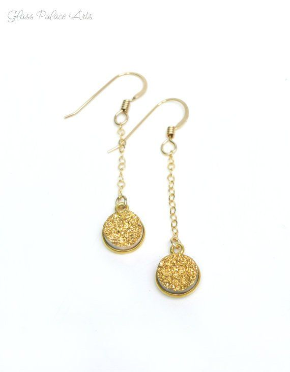 These genuine druzy gemstones sparkle and shine! - Druzy's measure about 8mm - Chain and ear wires are 14k gold filled - Total earring including ear wire dangles approx 45mm - All jewelry comes wrappe