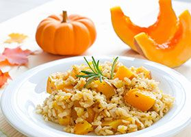 The traditional butter and cream in this recipe have been replaced with olive oil and yogurt. With pumpkin, the risotto achieves a creamy consistency without the extra fat.