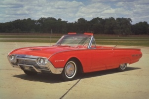 1962 Ford Thunderbird convertible. A fabulous 'personal car' available with a fiberglass tonneau cover that recreated the look of a two-seater, my father had a red one just like this.
