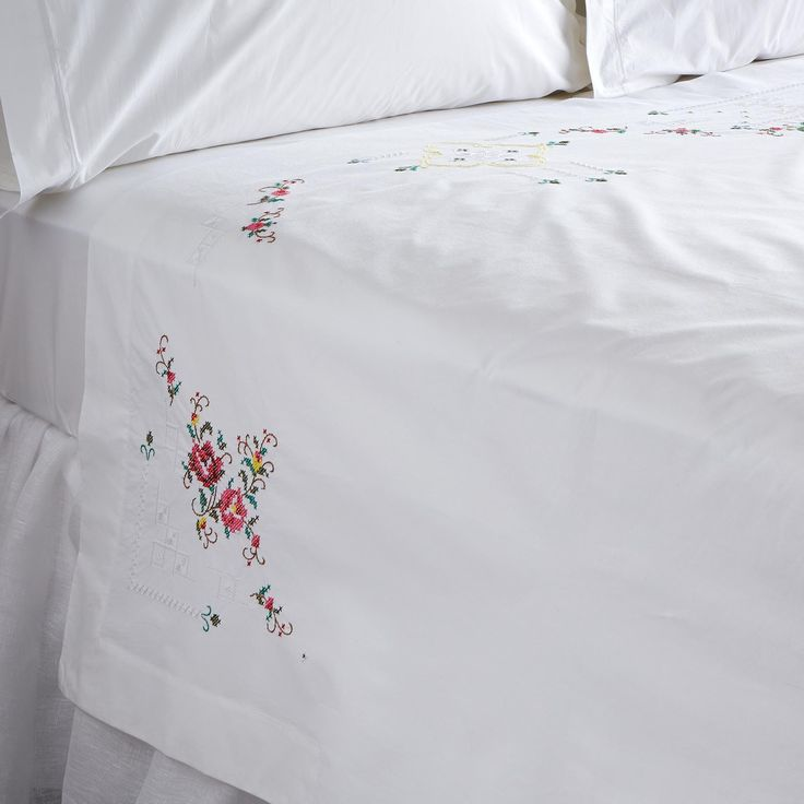 EMMA HEIRLOOM SHEET SET -- Lovingly detailed embroidery on crisp white cotton harkens memories of simpler times. Sheet set includes one embroidered flat sheet and one plain fitted sheet. Cotton. Imported. Catalog exclusive.