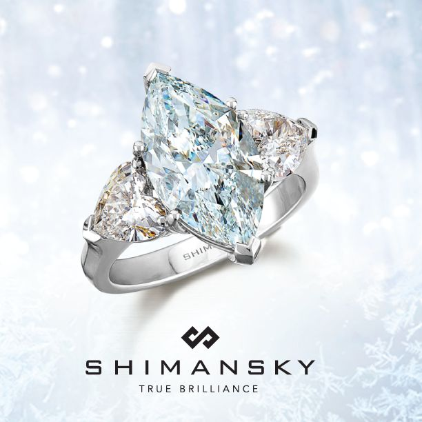 Shimansky bespoke fancy blue marquise diamond, embraced on either side by fancy heart-shaped diamonds and set in platinum.