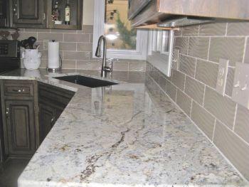 Granite countertop and tile backsplash in kitchen remodel | Angie's List
