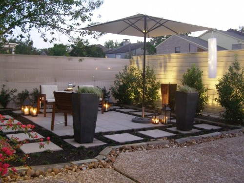 back yard space; stone tile; large planters; lighting