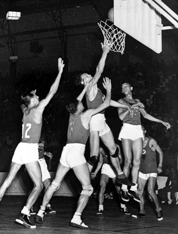 Ball goes in the net during an attack by France during their match against Brazil in the man\'s Olympic games basketball semi-final at Harringay Arena, London, Aug. 11, 1948. France beat Brazil 43 - 33 to meet USA in the Final.