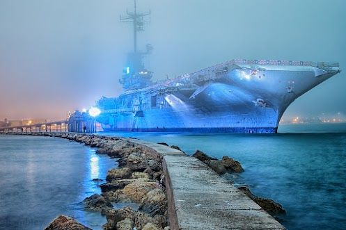 """The USS Lexington moored in Corpus Christi Texas-  She was reported sunk several times during WW II by the Japanese fleet but she always showed up again- this led her to be nicknamed the """"Blue Ghost"""" by Tokyo Rose."""