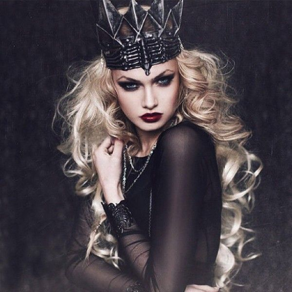 #HalloweenMakeup #DarkQueen We jump at any opportunityto don a crown and be a queen for the day. Wear a dark shade of red lipstick and create a dramatic smoky eye. Create a high brow arc using aneyebrow pencil. Style It With: A black dress, piles of silver jewelry, and, if the crown fits, wear it.