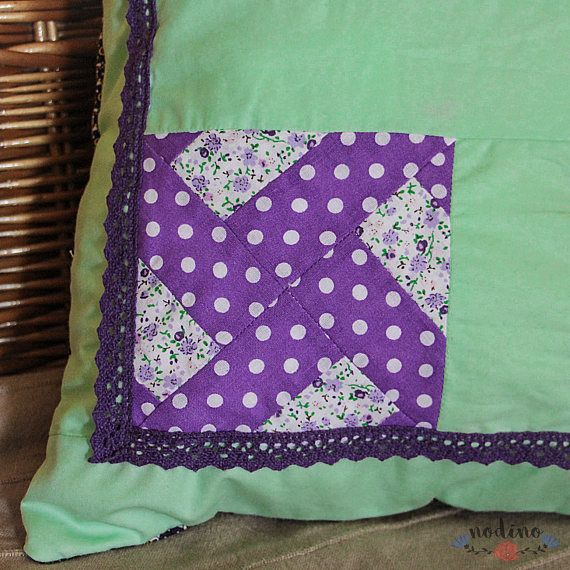 A patchwork pillowcase for decorative pillows. Thanks to its vibrant colours and to the lace decoration it is the perfect choice for a living room, bedroom, or for a babys room.  • SIZE | 40x40cm / 15.7x15.7 inches • FABRIC | 100% Cotton • COLOURS | apple green, purple and white • 100% hand made • Envelope-style closure (without buttons, also suitable for children), which makes it easy to insert the pillow • The interior is lined with white fabric • The cover is washable at 30 degrees  T...