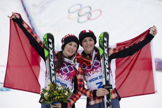 Canada's silver medalist Kelsey Serwa, left to right, and gold medalist Marielle Thompson celebrate their win following the Ladies Ski Cross...