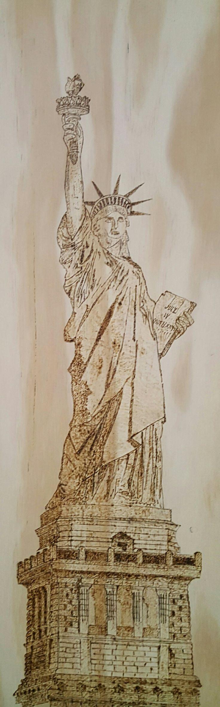 Statue of liberty pyrography by hady al hayek