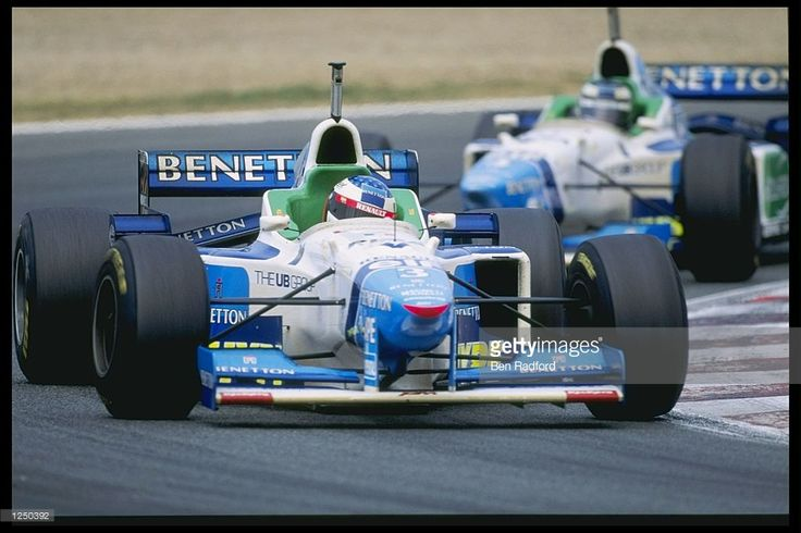 Jean Alesi of France and Gerhard Berger of Austria teamates for Benetton fight for third and fourth place during the French grand prix in Magny Cours, France. Mandatory Credit: Ben Radford/Allsport UK