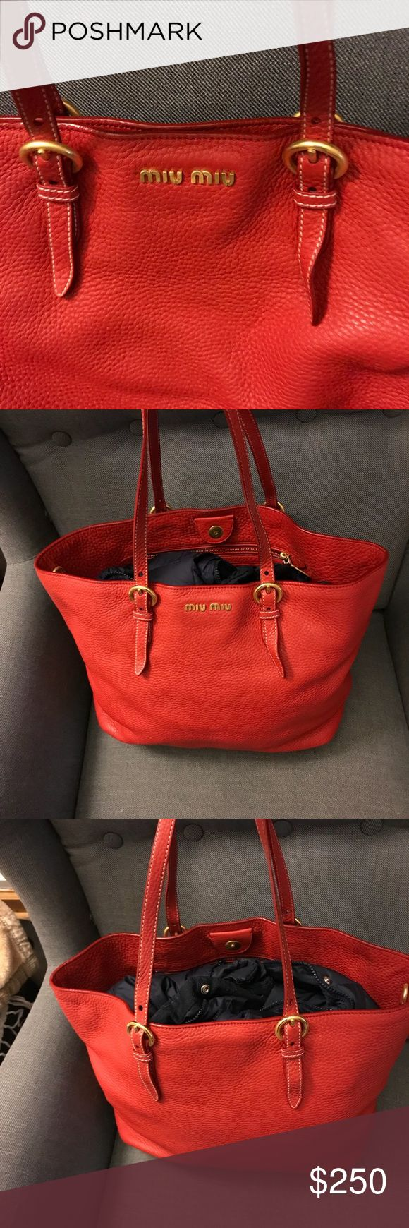 Miu Miu Handbag Tote The bag was purchased at a Prada Outlet Store in 2016. It has 3 pockets inside; one is smaller than the other two. The two larger pockets have zippers. The bag is a nice red when seen in person. It has some staining inside of the bag and pockets. I have pictures to show. Please ask more questions if need be. It was the end of the season when I bought it. Thanks! FYI-there is a coat inside to make it seem More full. The coat is sold separately. Thanks! Miu Miu Bags Totes