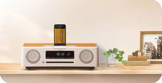 Yamaha YAMAHA TSX-132 - Listen to your favorite tunes, check the time, wake up to music – the TSX-132 is perfect for your bedroom or beyond. The design is delightfully attractive, with a softly rounded form and real wood top panel. The audio performance is exceptional, delivering deep bass and clear mids and highs.