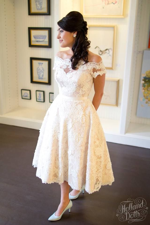 Off the shoulder lace gown with blush underlay.  Custom Tea Length, keyhole back, blush wedding gown by Modern Trousseau Charleston.  1950s inspired wedding dress with skinny belt.  Love the baby blue shoes!