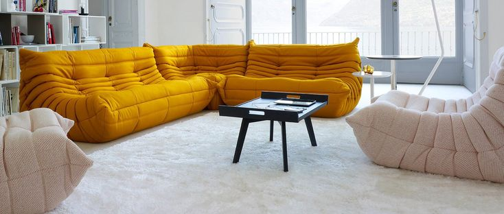 Instantly recognisable from its distinctive shape, the Togo Sofa has remained a cult classic for over 40 years. Hand sewn in the small French village of Briord, this modular, corner sofa has a curved silhouette providing the characteristic pleats of crumpled fabric and also making it the ideal seat to lay back and relax into.