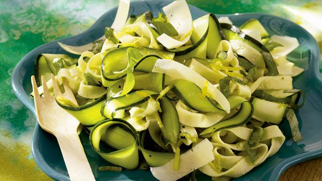 Pasta salad gets a new look when zucchini is cut into thin pasta-like ribbons rather than the usual slices. The zucchini is marinated overnight in the salad's flavorful dressing before it's tossed with fettuccine, basil and Parmesan cheese.