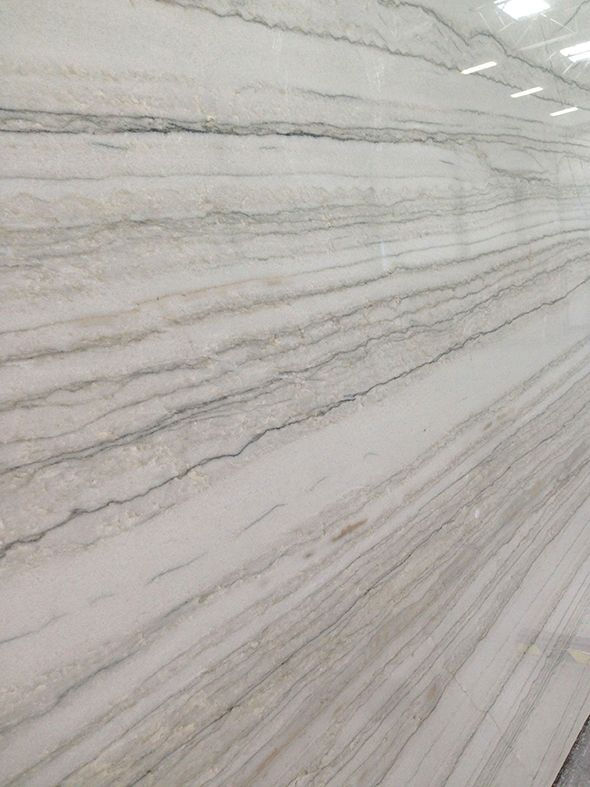 Macaubus quartzite -  It's mostly a soft gray color and has the beautiful veining that we all love, but it wears much harder than a marble - more like a granite.