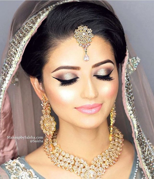 "This Beauty  Gorgeous bride Sundus! I used @salehabeauty lipgloss in ""Bella"" & ""Hollywood Gold"" highlighter ✨ #saleha #makeup #mua #makeupartist #bride #bridalmakeup #salehasbride"