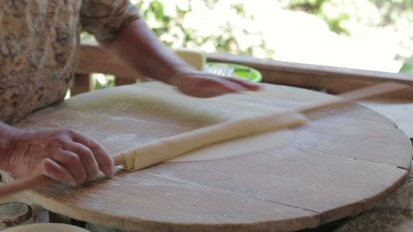 Female Hand Rolled Dough Cake