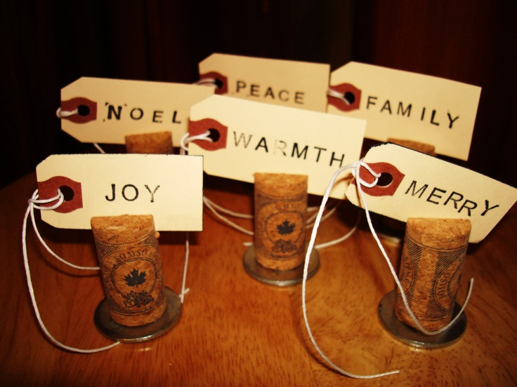 With people's names on them, these could be place cards that the guests can remove from the corks and use as wine glass/beer bottle namecards for the rest of the night... :)