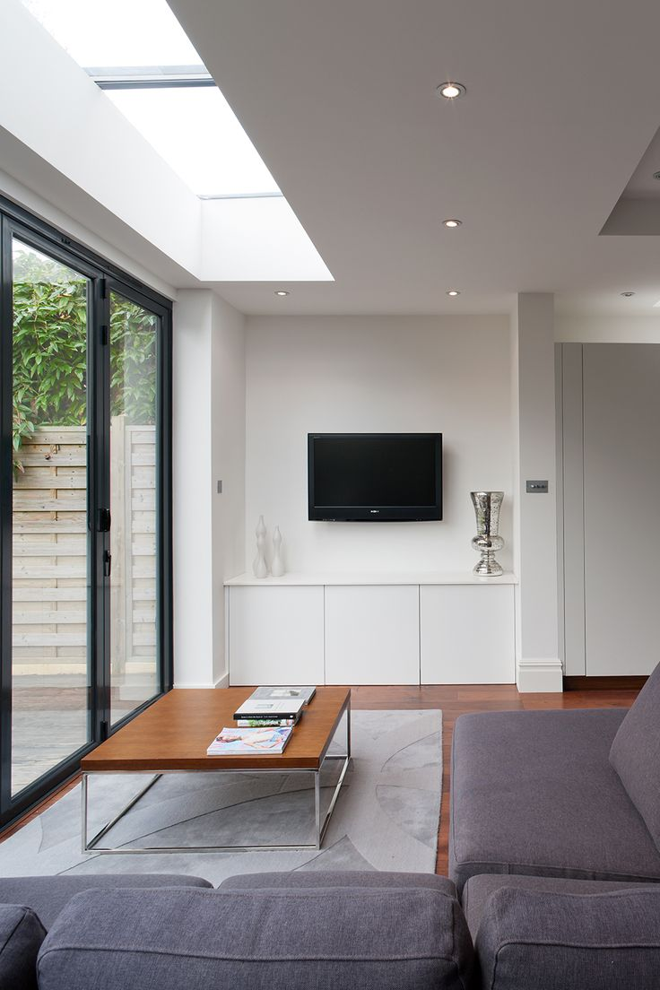 The objective was to create a large and bespoke family kitchen, dining and informal entertaining space, maximising the use of natural light and with easy access to the garden. We designed a clean, modern design and a bespoke kitchen. Sliding-folding doors allow the back to be fully opened up and...